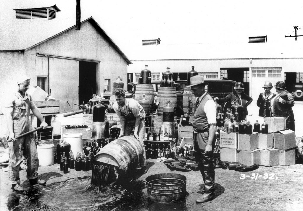 Prohibition 1920: Dumping barrels of alcohol into a field during the Prohibition Era